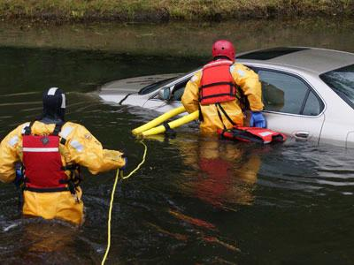 Firefighters Help Woman to Safety After Car Goes Into Pond
