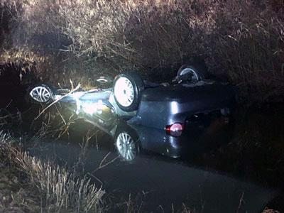Woman trapped in submerged vehicle